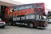 Double Decker bus wrapped in General Formulations Automark advertising Melbourne Tigers