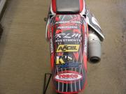 Another dirt bike tail wrapped with General Formulations Motomark with various sponsor logos on it