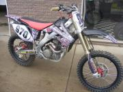 Another dirt bike with General Formulations MotoMark with an advertisement for Michigan Honda on it