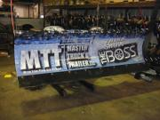 Another snow plow wrapped with General Formulations MotoMark advertising for MTT Master Truck and Trailer