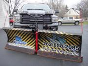Another snow plow wrapped with General Formulations MotoMark advertising for RC property works
