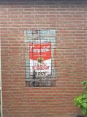 Campbells soup decal on brick wall